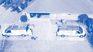 Two Service Vans at Home in Montone Blue | Climate Masters INC | AC Installation Near Me | AC Companies Near Me