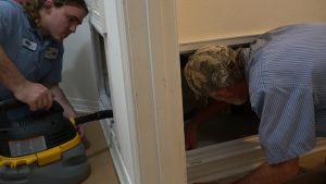 Two HVAC technicians working on air intake closet   Climate Masters INC   AC Repair near me   HVAC near me