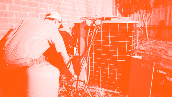 HVAC technician servicing outdoor unit | Climate Masters INC | Air Conditioning Repair