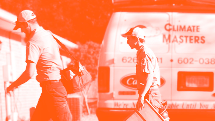 Two HVAC repair technicians walking by service van in orange monotone | Climate Masters INC | HVAC Repair