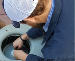 Climate-Master-employee-working-duct-installation