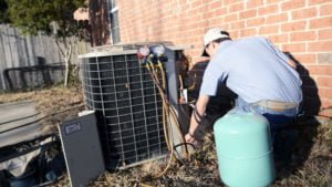 Climate Master employee working on heating and cooling unit.